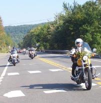 Alice cruising PA Rt 6 on her award winning yellow Dyna