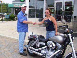 Diana purchases new Harley Davidson