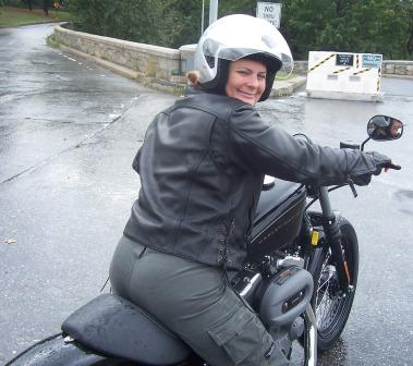 Diana cruising on 2010 Nightster