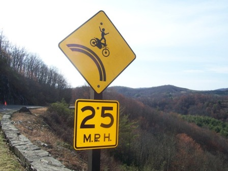 beware motorcycles falling over cliff