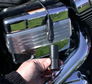 close up of 12 volt cigarette lighter plug for motorcycle