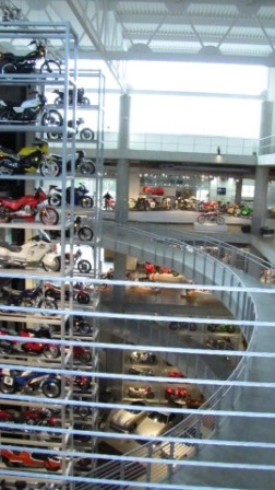 Motorcycles line the elevator shaft at Barber museum
