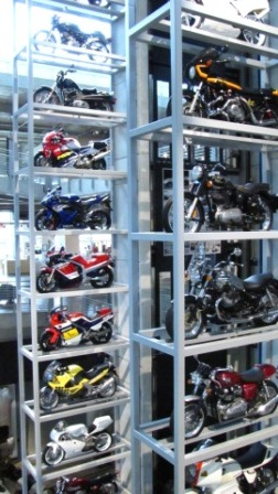 towers of motorcycles line elevator shaft at 4 corners
