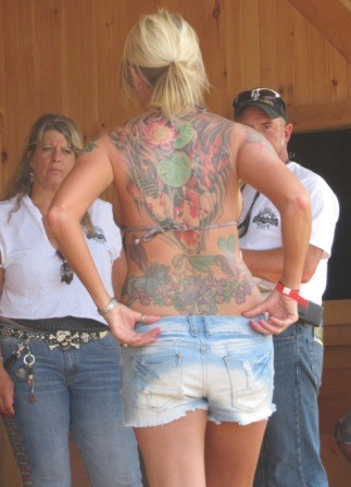 pretty blonde chick has tats on the butt