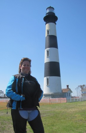 Diana poses in front of the Bodie Island Lighthouse in North Carolina
