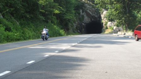 motorcycle on skyline drive coming throughtunnel
