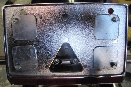 layflat license plate holder with fake bolts and now 2 new holes